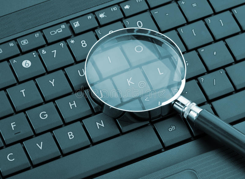 Download Magnifying glass on laptop stock image. Image of glass - 23858597