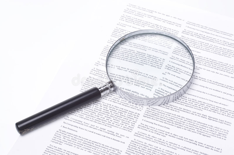 Magnifying Glass Lying On A Legal Contract Stock Images - Image