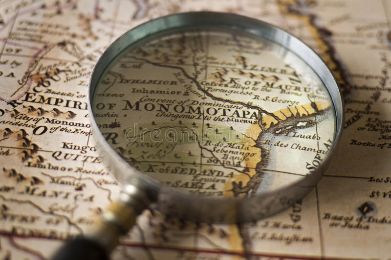 Magnifying Glass On Top Of An Old Map Stock Photo Image of
