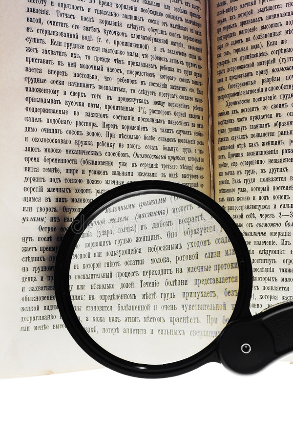 Free Magnifying Glass On Book Stock Photo - 5931630