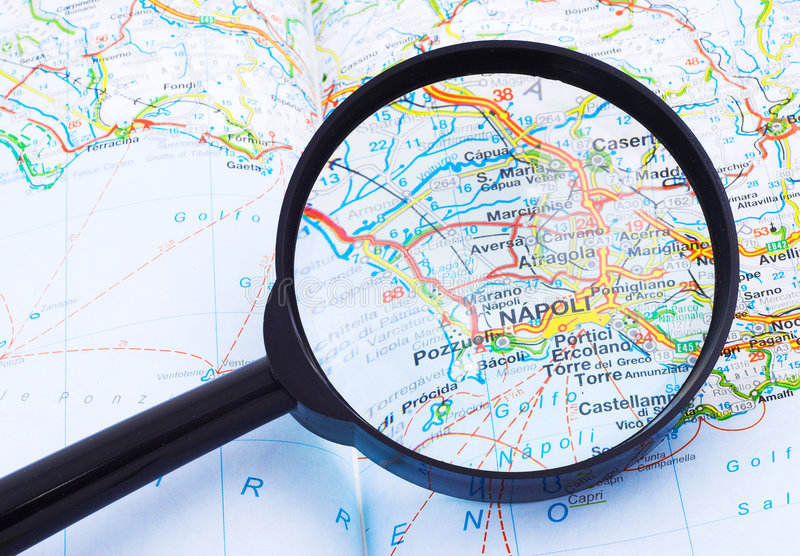 Magnifying glass over Napoli, Italy map royalty free stock image