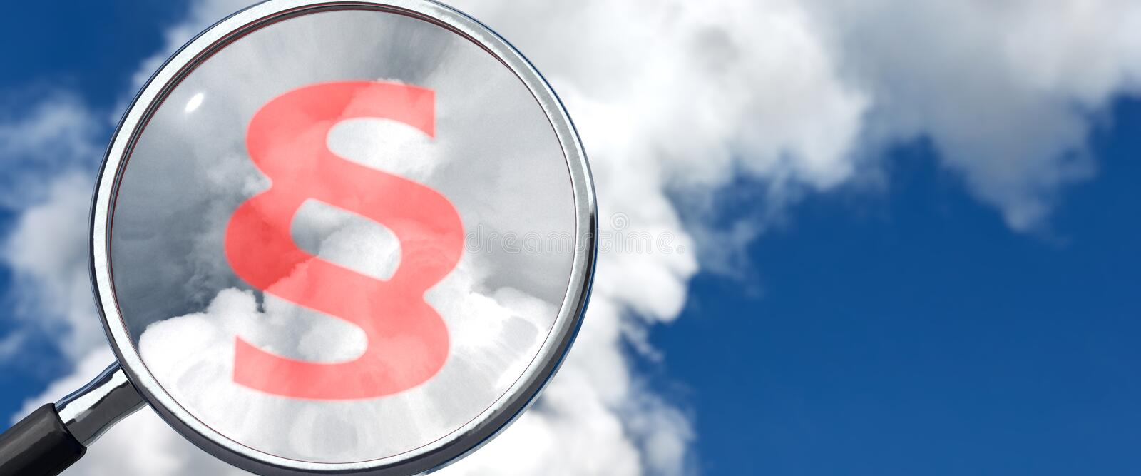 Emissions and law. Magnifying glass with paragraphic symbol and blue sky with emissions in background royalty free stock photography