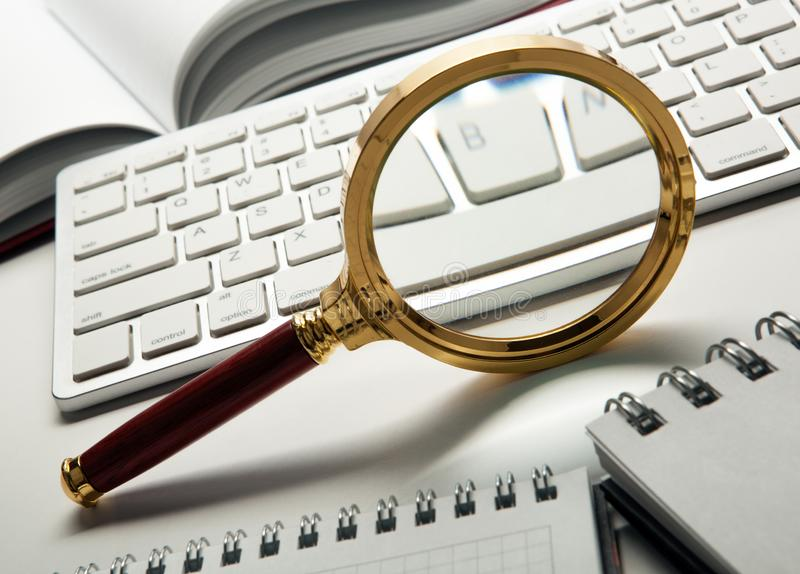 Magnifying glass on the pc keyboard search technolog. Y concept stock images