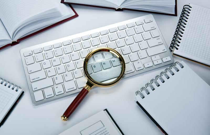 Magnifying glass on the pc keyboard search technology. Concept stock image