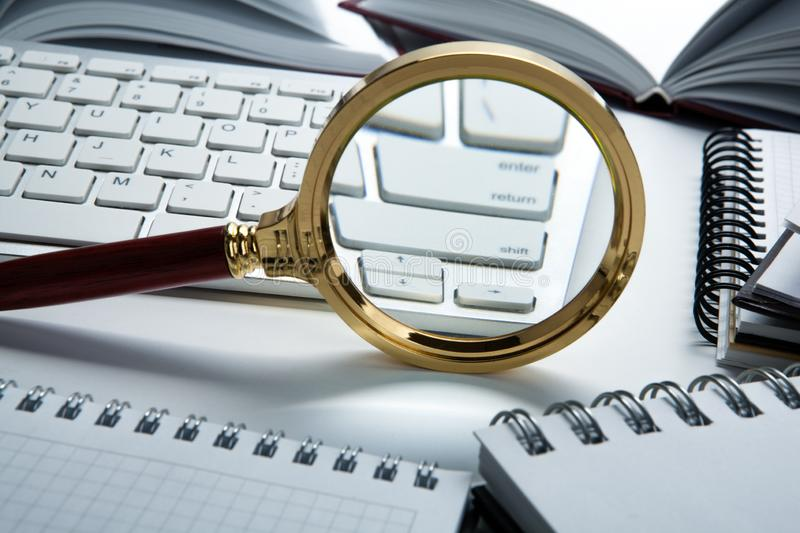 Magnifying glass on the pc keyboard search technology. Concept stock photo