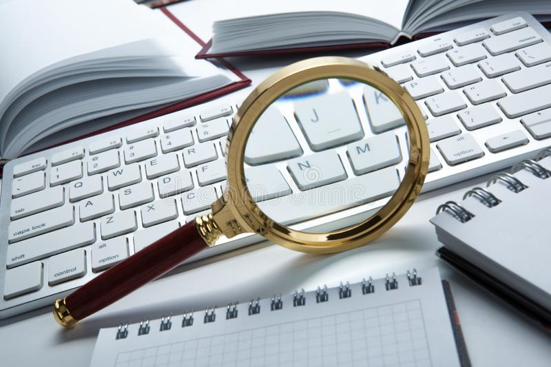 Magnifying glass on the pc keyboard search technology. Concept stock images