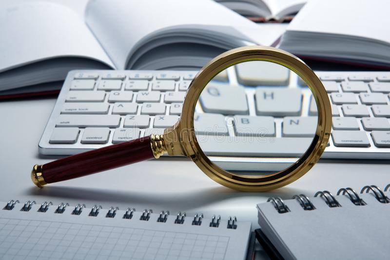 Magnifying glass on the pc keyboard search technology. Concept royalty free stock images