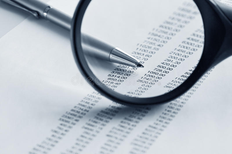Download Magnifying Glass  And Pen Over Financial Report Stock Image - Image: 11260451