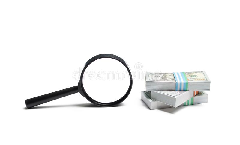 Magnifying glass and a pile of money. Concept of fundraising, attracting investments. Loan to paycheck, urgent loans. stock photo