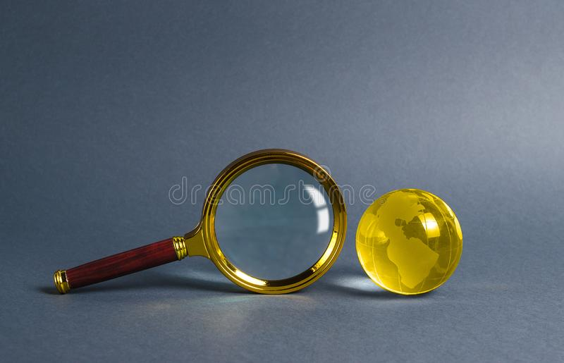 Magnifying glass and planet earth glass ball. Concept of global search and globalization process. International business. And logistics. Search engine stock image