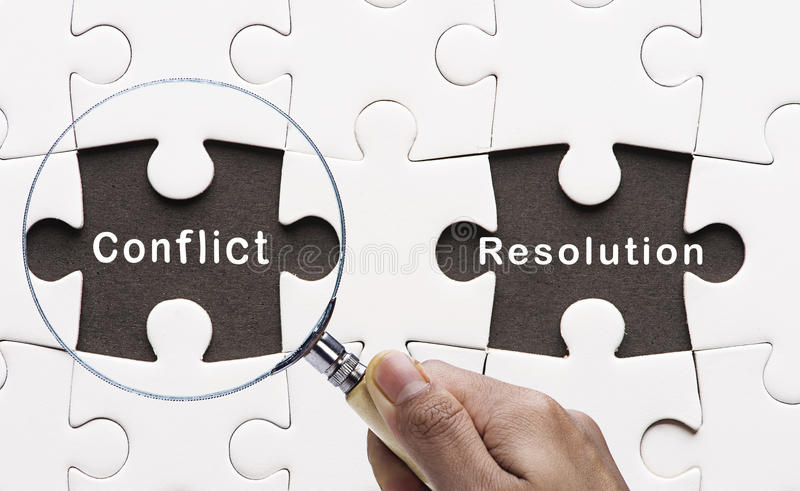Magnifying glass search missing puzzle peace. Magnifying glass searching missing puzzle peace Conflict Resolution stock photography