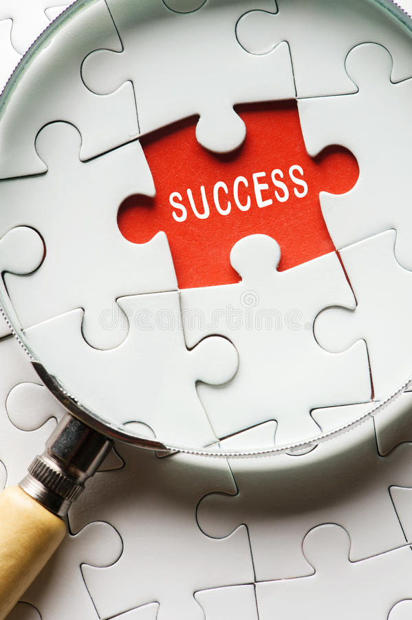 Magnifying glass searching missing puzzle peace SUCCESS stock photos