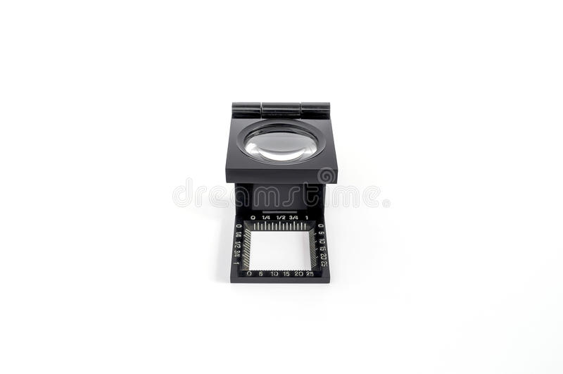 The magnifying glass standing usage for test printing. On white background royalty free stock images