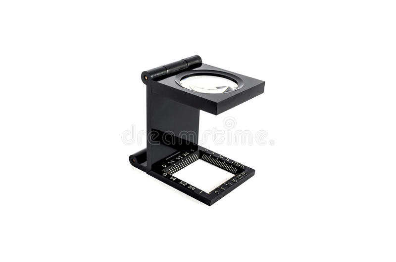 The magnifying glass standing usage for test printing. On white background stock photography