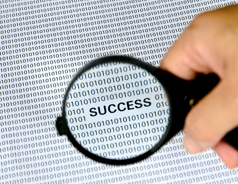 Magnifying glass with success word. On background stock photo