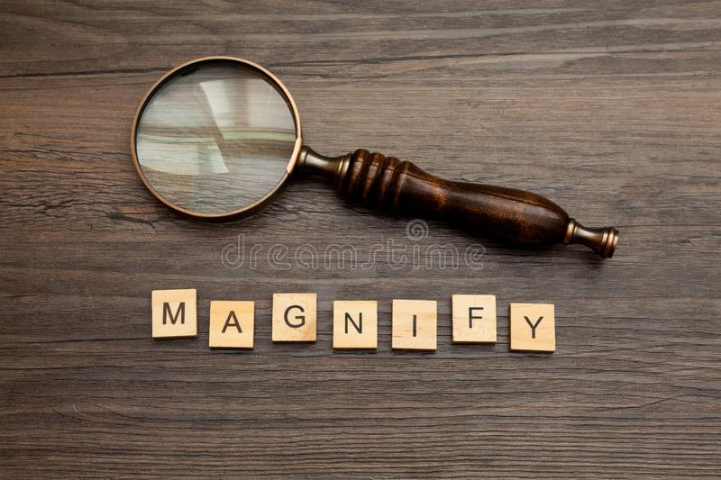 Magnifying Glass with the word - Magnify. Old fashioned magnifying glass with the word - magnify stock photography
