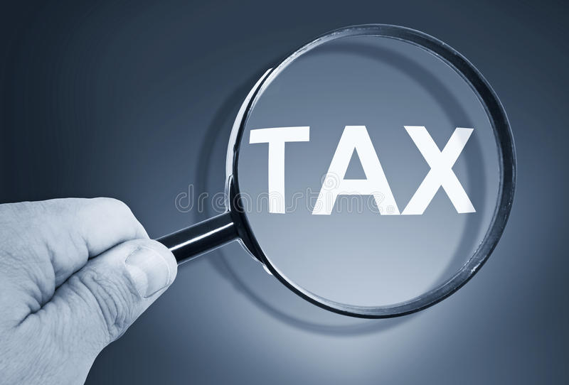 Magnifying glass with word tax royalty free stock photography