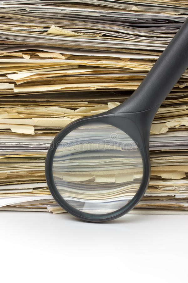 Download Magnifying Lens  On The Old Files Stack Background Royalty Free Stock Photography - Image: 20487487