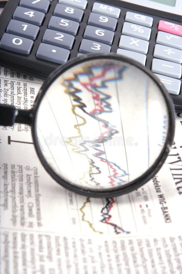 Magnifying over financial graph stock photography