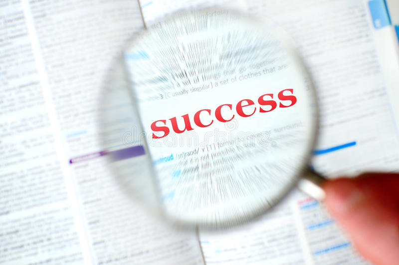 Magnifying success word. From book royalty free stock photography