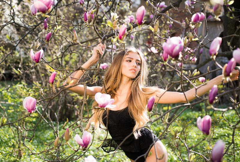 Magnolia blossom. spring. Womens underwear. Beauty and fashion. Sensual woman. makeup and hair style. trendy look. Sexy. Girl. long healthy hair. happy woman stock photography