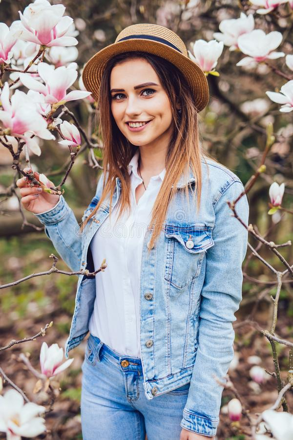 Magnolia. girl or cute woman near blossoming, magnolia flowers tree in spring park on spring sunny day stock image