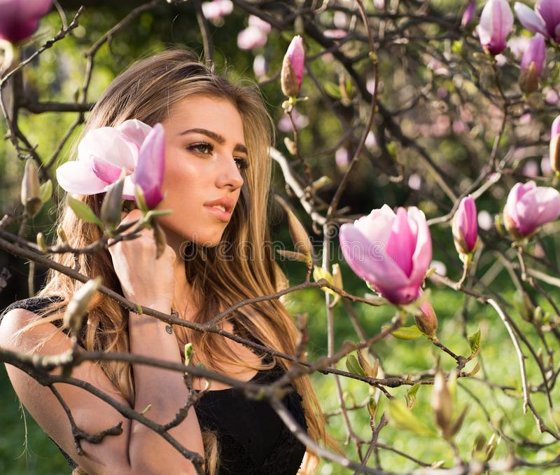Magnolia. Spring girl in blooming garden. Summer girl and sensual moment. Beauty woman outdoors in blooming trees. Beauty girl in flowers stock image