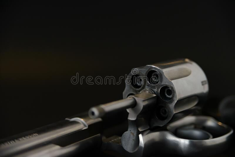 357 magnum caliber revolver pistol, cylinder open with bullets protruding from the gun.  royalty free stock photo
