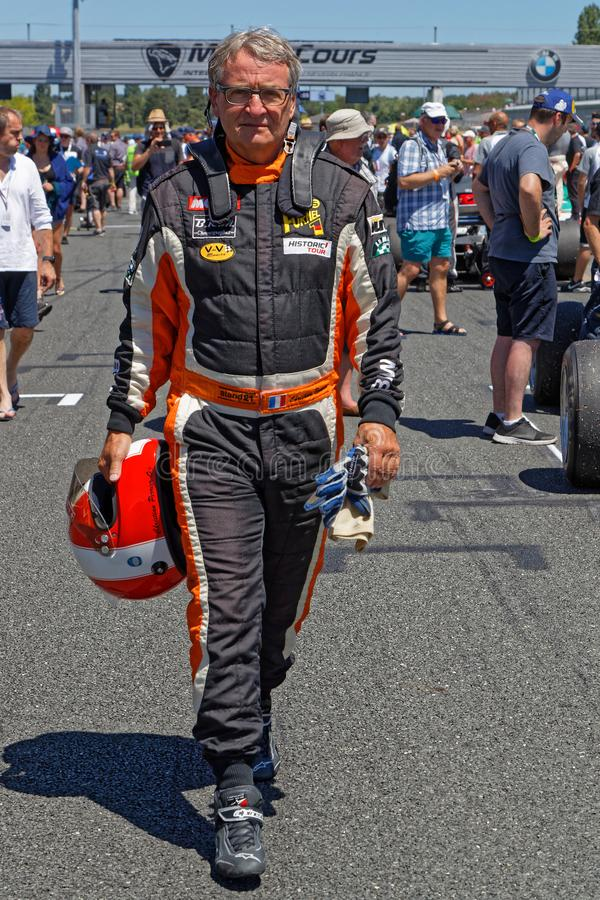 Driver on starting grid of French Historic Grand Prix royalty free stock photo