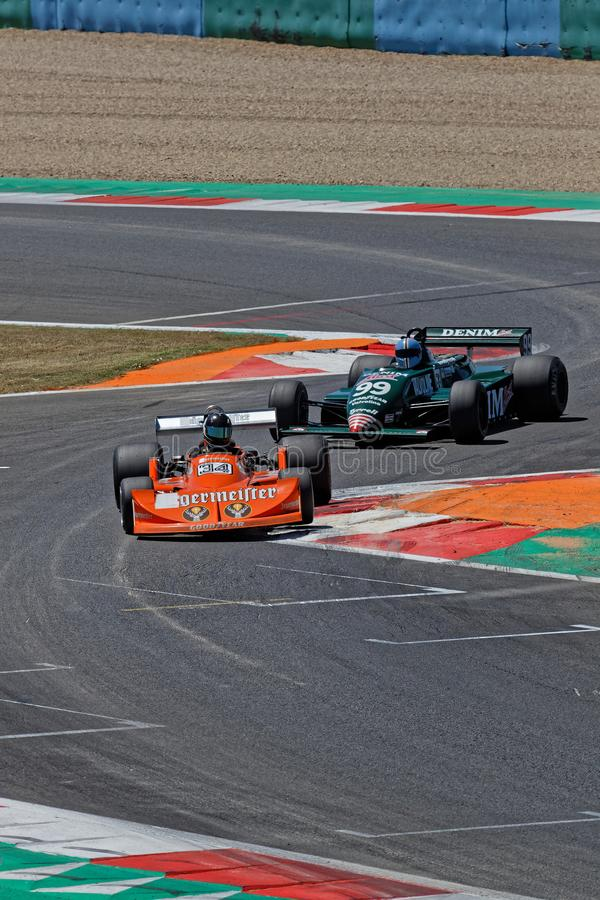 Formula one pack attacks at the chicane. MAGNY-COURS, FRANCE, June 29, 2019 : Formula one pack at the chicane. French Historic Grand Prix takes place on Magny stock photo