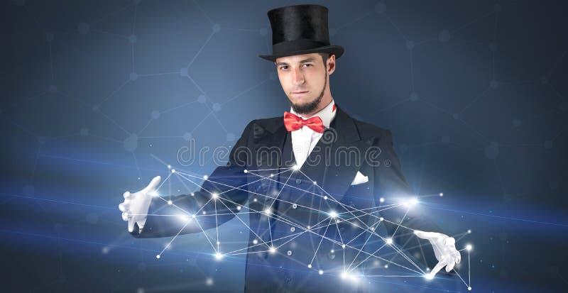Mago con la conexión geométrica en su mano imagen de archivo