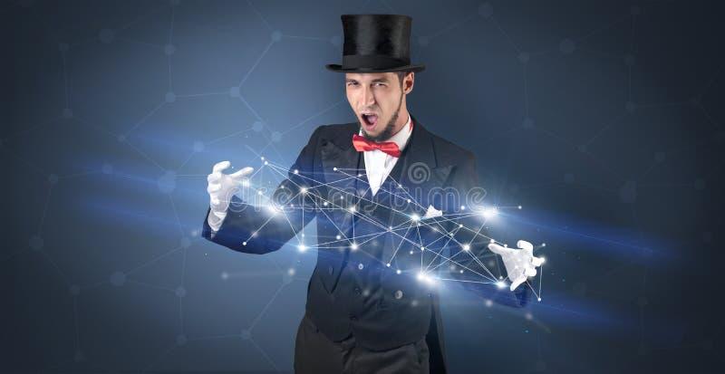 Mago con la conexión geométrica en su mano imagen de archivo libre de regalías