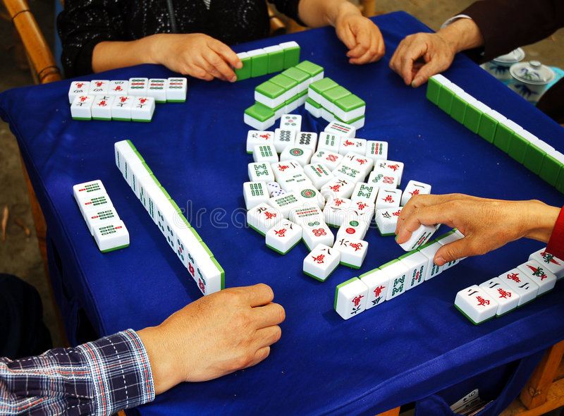 Mah-jong. Senior people playing mah-jong with friends in Chengdu,capital of Sichuan,west of China stock photography