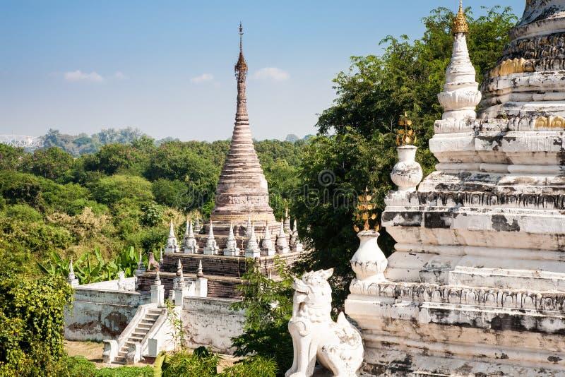Maha Aung Mye Bon Zan monastery, Mandalay, Burma. Some smaller pagodas in the Maha Aung Mye Bon Zan monastery complex in the historic site of Inwa or Ava near stock photography