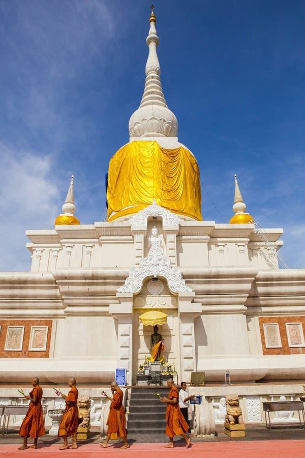 MAHASARAKHAM THAILAND - JULY8,2017 : thai buddha munk praying ar. Ound Prathat Nadun pagoda most important buddhism place in Mahasarakham province north eastern royalty free stock photography
