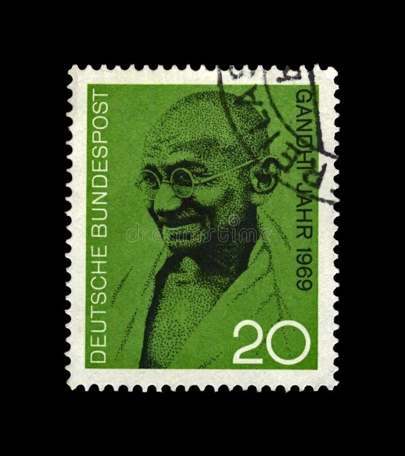 Mahatma Gandhi aka Mohandas Karamchand Gandhi, famous indian activist, indian independence movement leader,. GERMANY - CIRCA 1969: canceled stamp printed in royalty free stock photo