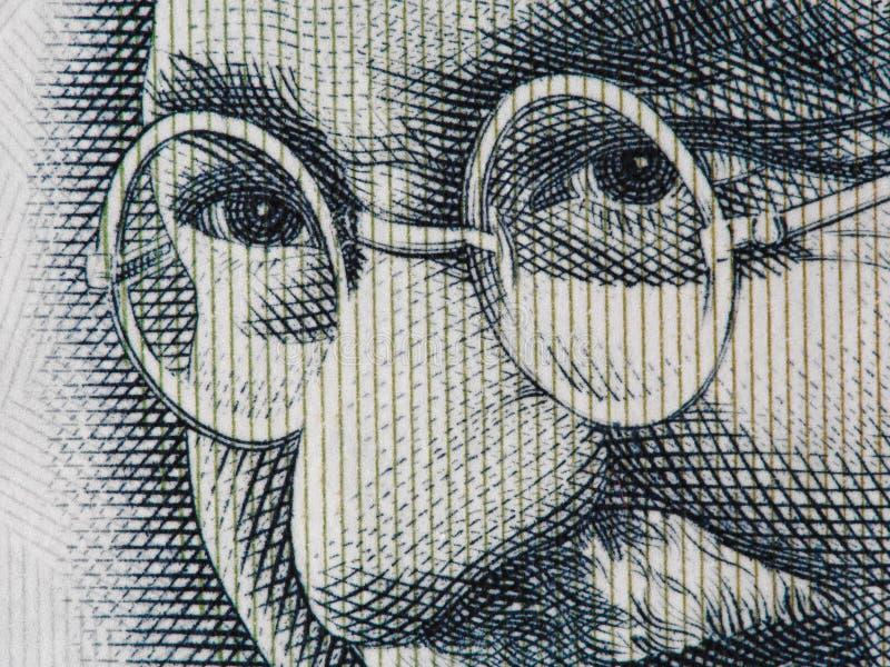 Mahatma Gandhi face on indian 100 rupee banknote extreme macro, stock image
