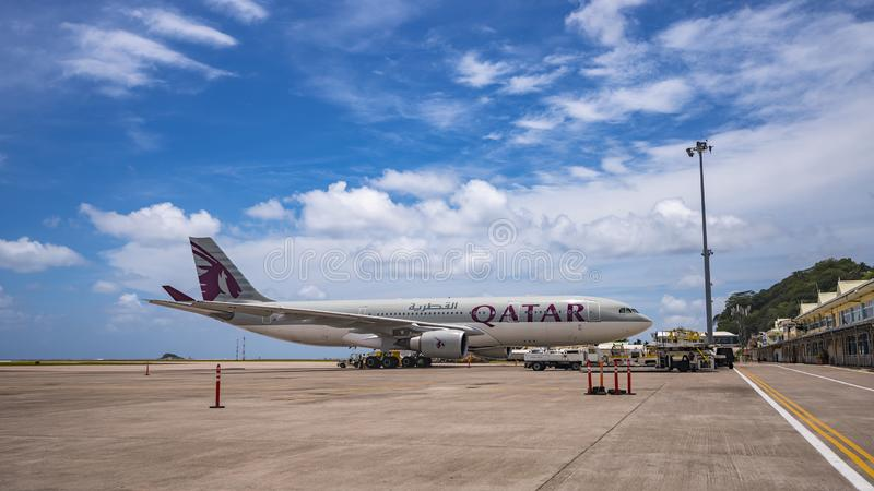 MAHE, SEYCHELLES - OCTOBER 4, 2018: Qatar Airways Plane at Mahe airport in Seychelles. Qatar Airways is included in the list of royalty free stock photography