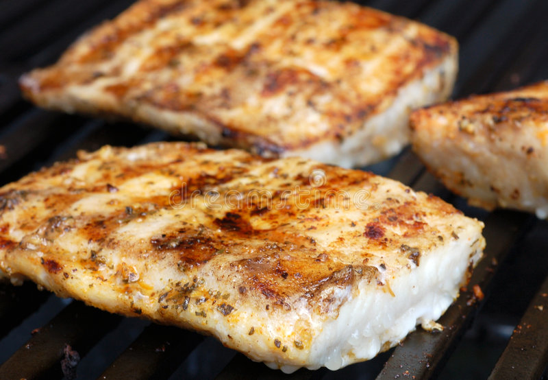Mahi. On the grill at a cookout stock photos