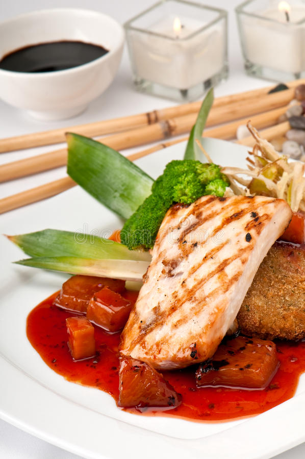 Mahi Mahi Orientale Served. Plate of Mahi Mahi, severd with vegetables, pineapple and soy sauce royalty free stock images
