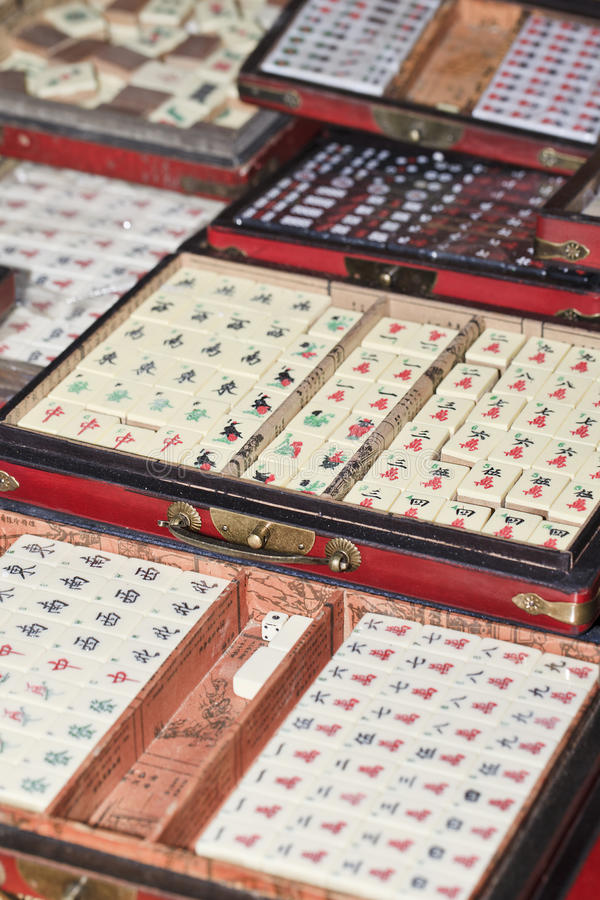 Mahjong boxes on Panjiayuan Market, Beijing, China. BEIJING-JAN. 26. Mahjong boxes on a market. Mahjong is originated from China, commonly played by four players stock image