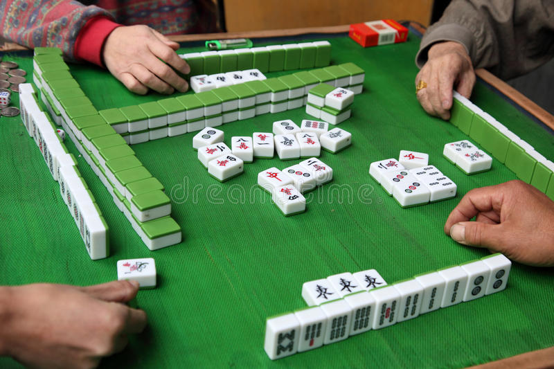 Mahjong Game. Chinese people playing Mahjong. Shanghai China royalty free stock photo