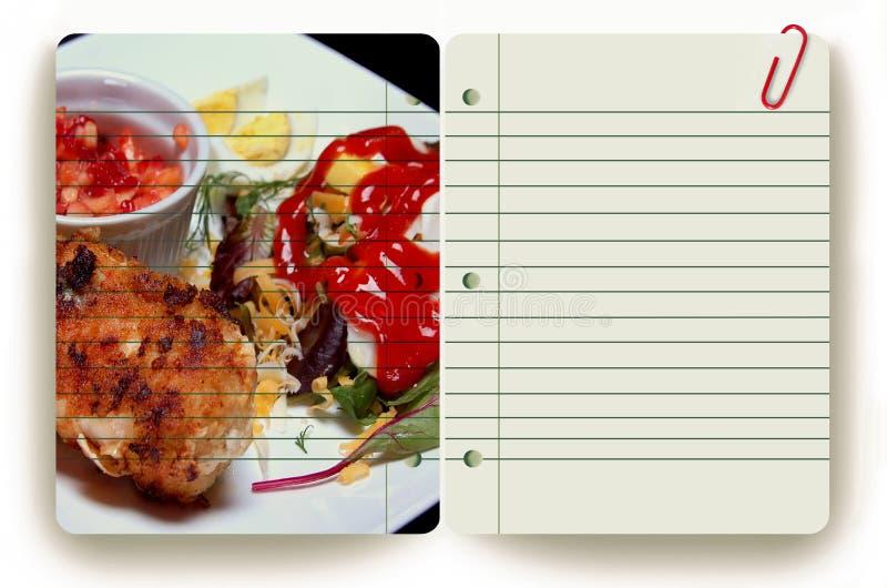 Mahlzeit und Notizblock stockbilder