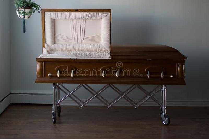 Funeral Home Mahogany Casket. A mahogany casket in a funeral home royalty free stock photo