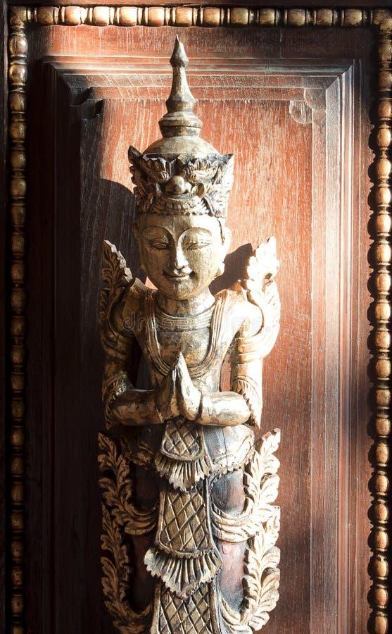 MAI DI CHAIANG, TAILANDIA - 26 GENNAIO 2014: Figura antica scolpita decorativa di Mandarin Oriental Dhara Dhevi Chiang Mai, Thail fotografie stock