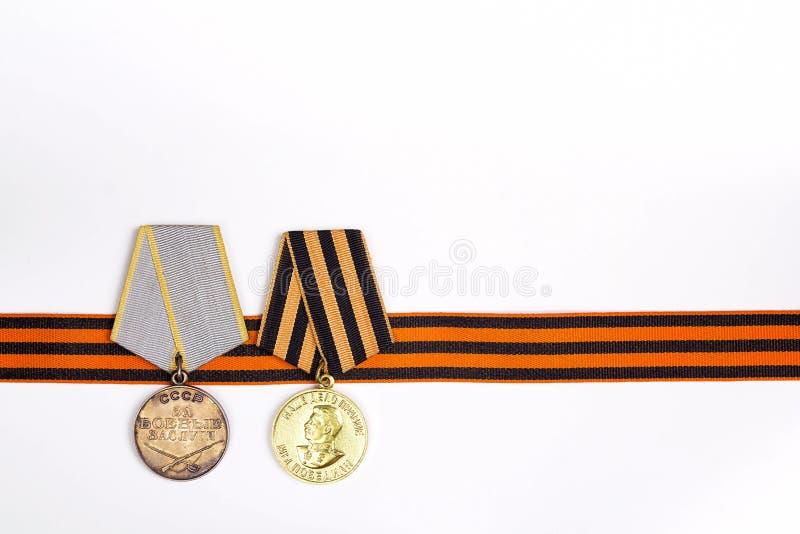 9 mai fond Ruban du ` s de St George et médailles de grand patriote photographie stock libre de droits