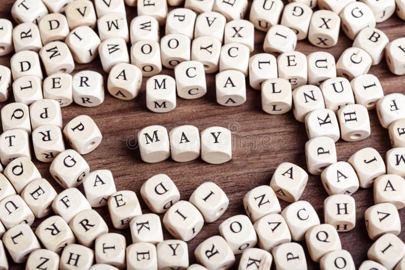 Mai, lettre découpe le mot photographie stock