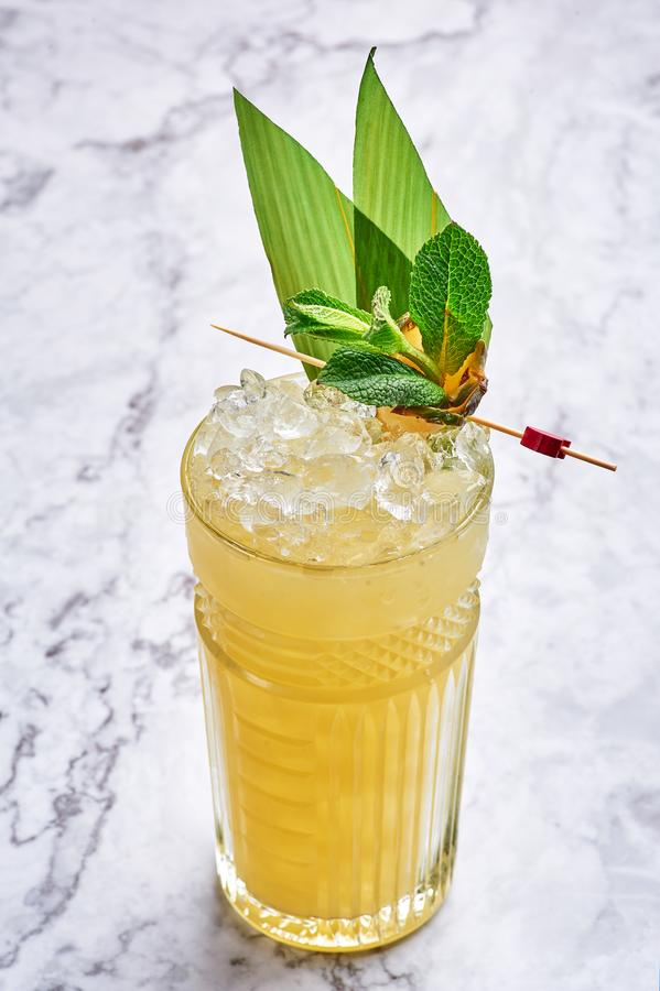 Mai tai - classic alcohol long drink hawaiian cocktail at white marble background stock photos
