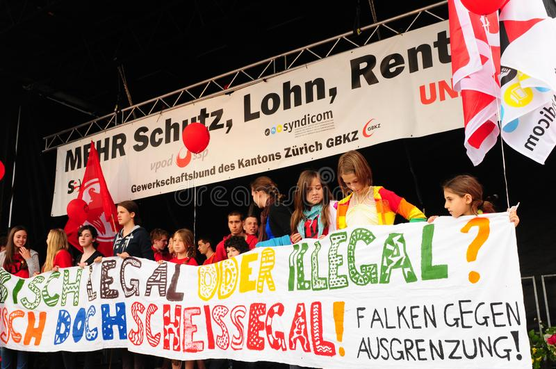 1. Mai: young female protestors demanding for more humanity for immigrants stock photography
