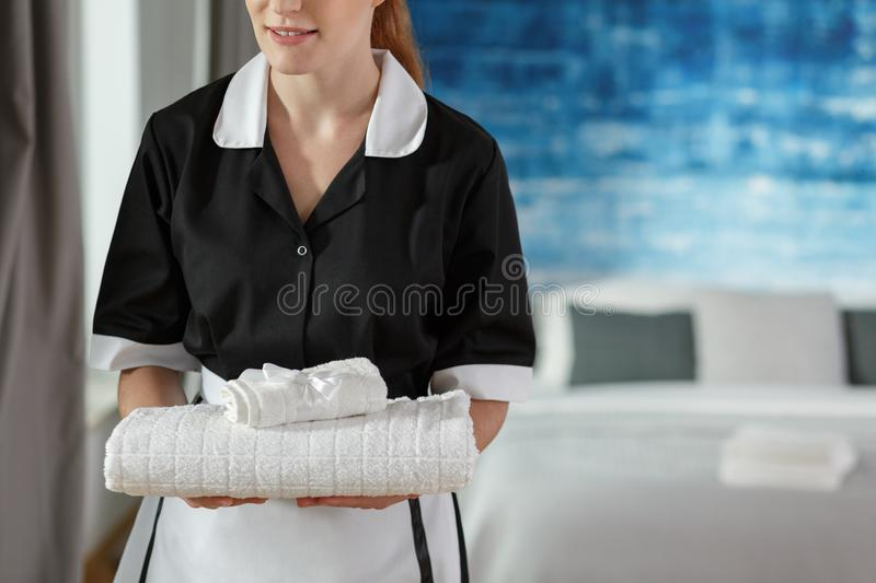 Maid changing towels royalty free stock photography